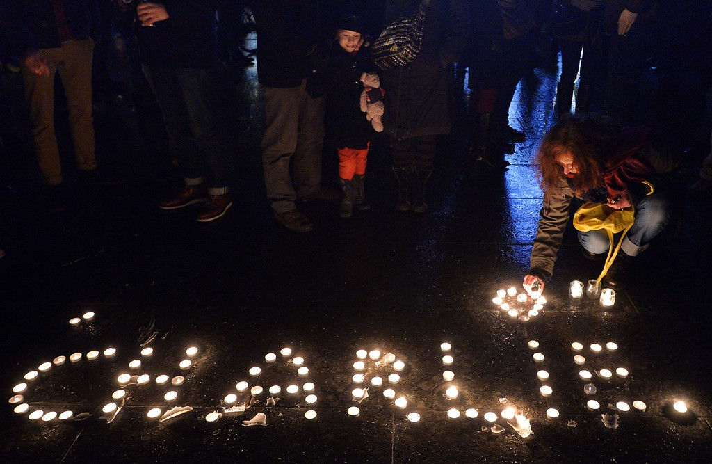 ". People light candles forming the name Charlie during  a gathering in Strasbourg, eastern France, on January 7, 2015, following an attack by unknown gunmen on the offices of the satirical weekly Charlie Hebdo. Heavily armed men shouting ""Allahu Akbar\"" stormed the Paris headquarters of a satirical weekly on January 7, killing 12 people in cold blood in the worst attack in France in decades.  AFP PHOTO / PATRICK HERTZOG/AFP/Getty Images"