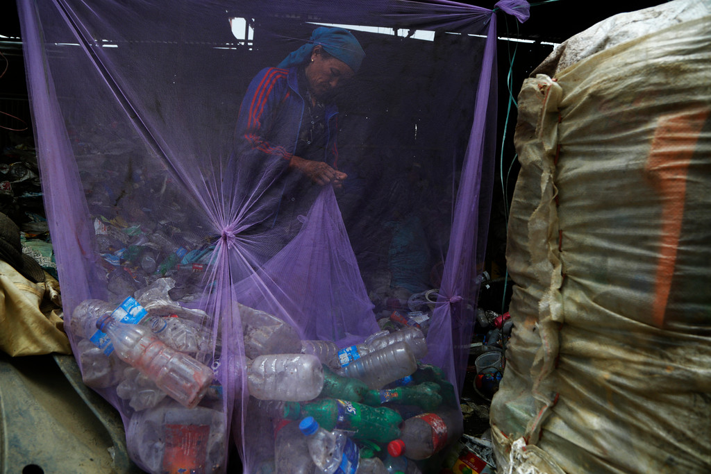 ". A worker segregates plastic waste for recycling at a junkyard in Kathmandu, Nepal, Monday, June 4, 2018. The theme for this year\'s World Environment Day, marked on June 5, is ""Beat Plastic Pollution.\"" (AP Photo/Niranjan Shrestha)"