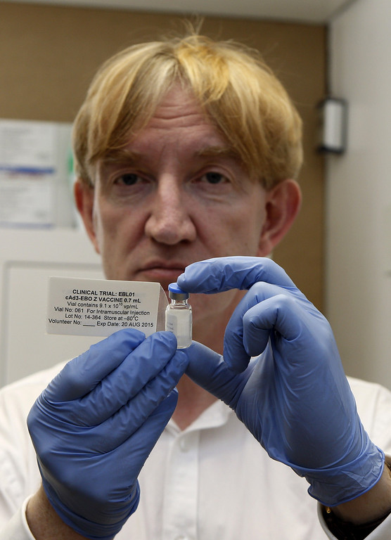 . Professor Adrian Hill, director of the Jenner Institute and chief investigator of the trials with the Ebola vaccine Chimp Adenovirus type 3 (ChAd3), holds a vial of the vaccine before injecting it into British volunteer Ruth  Steve Parsons/AFP/Getty Images