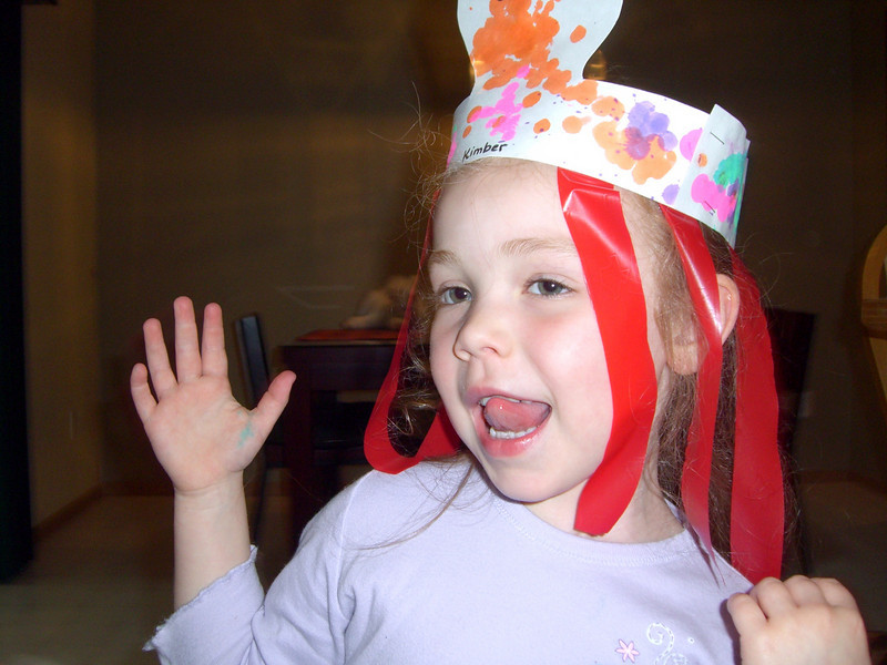 Modeling an octopus hat she made at daycare that day.