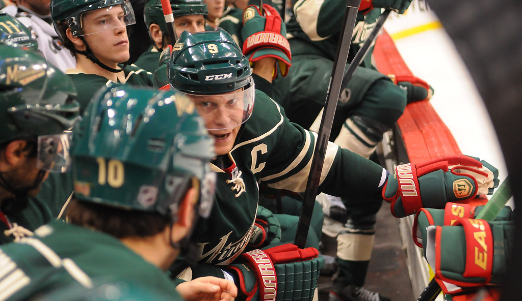 . Minnesota center Mikko Koivu discusses play with teammates on the bench before his next shift  in the third period against the Blackhawks. (Pioneer Press: John Autey)
