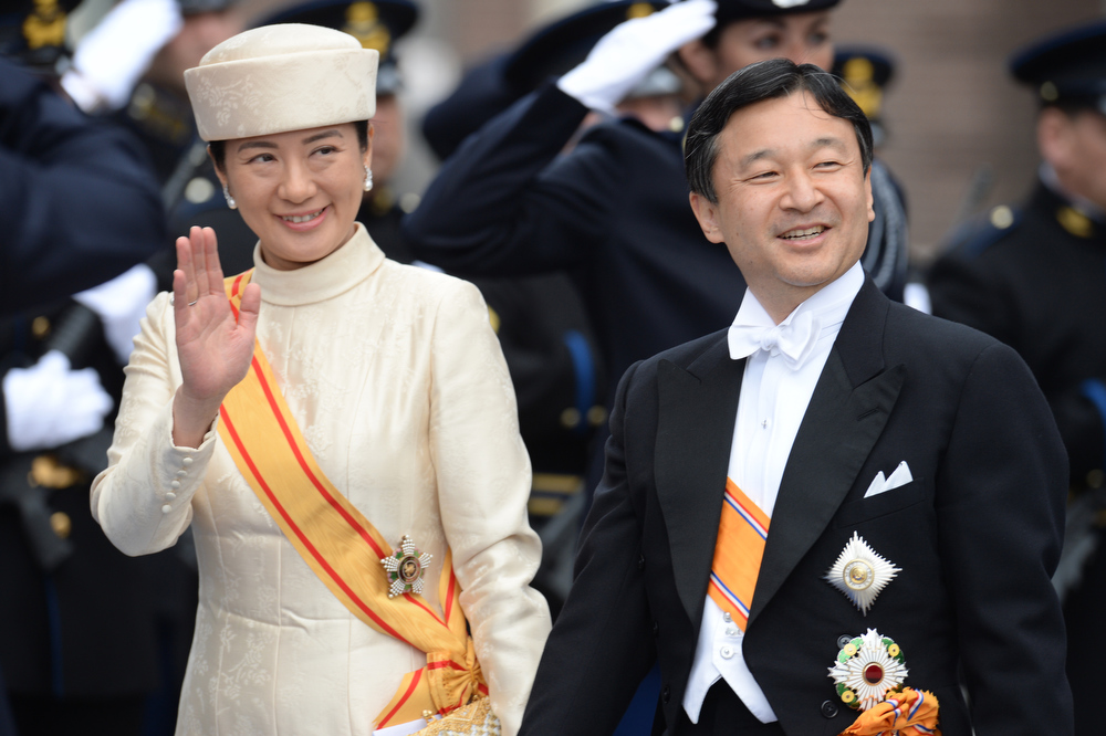 . Japan\'s Crown Prince Nahurito (R) and his wife Crown Princess Masako leave the Nieuwe Kerk (New Church) in Amsterdam on April 30, 2013 after attending the investiture of King Willem-Alexander of the Netherlands.  PATRIK STOLLARZ/AFP/Getty Images