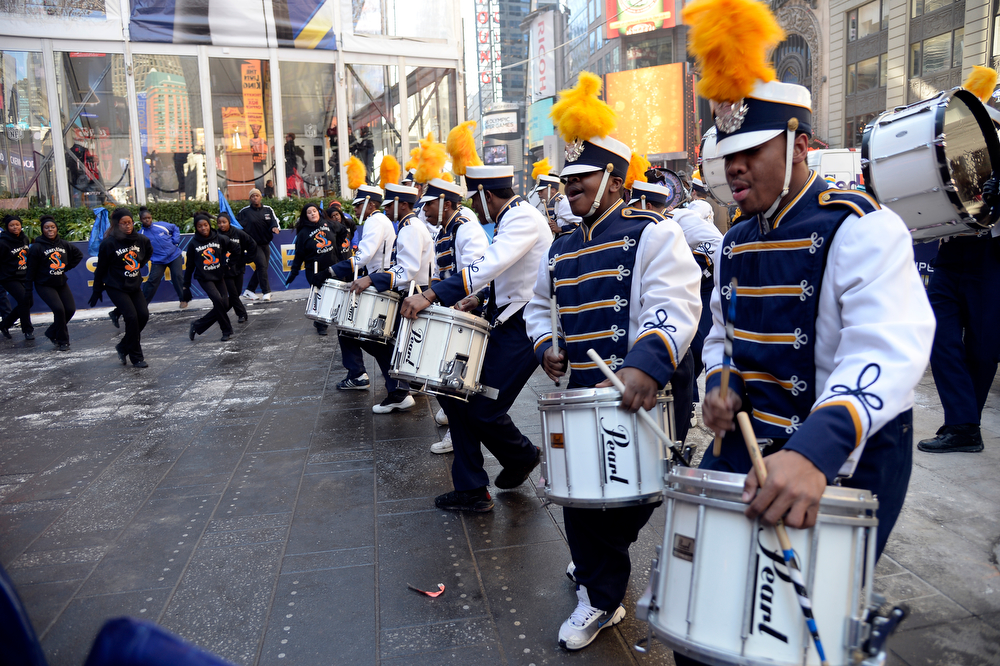 . Members of the Greenburgh North Castle Marching Band entertain the crowd as Super Bowl XLVlll fans hit Times Square to enjoy the Super Bowl Boulevard. The NFL transformed a portion of Broadway into the sports and entertainment hub of Super Bowl Week, January 29, 2014. (Photo by John Leyba/The Denver Post)