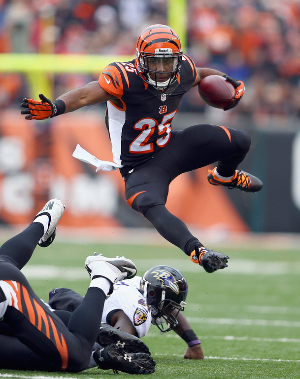 . Giovani Bernard #25 of the Cincinnati Bengals runs with the ball during the NFL game against the Baltimore Ravens  at Paul Brown Stadium on December 29, 2013 in Cincinnati, Ohio.  (Photo by Andy Lyons/Getty Images)