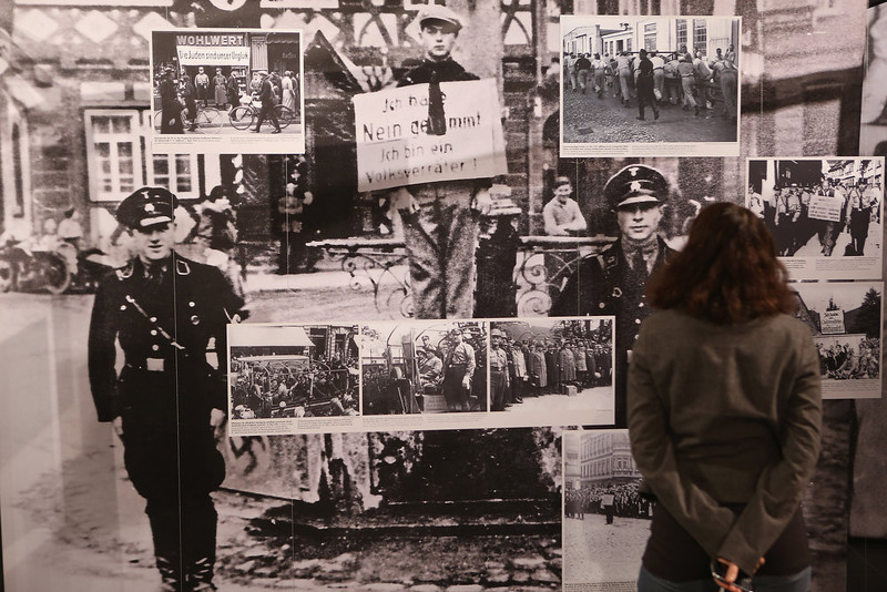 ". A museum worker looks at one of exhibits at the exhibition ""Berlin 1933 - The Path To Dictatorship\"" at the Topography of Terror documentation center and museum on January 29, 2013 in Berlin, Germany. The exhibition, which opens officially tomorrow, examines the period in 1933 shortly after Adolf Hitler assumed power and the Nazis began murdering and intimidating political opponents as well as persecuting Jews. 2013 marks the 80th anniversary of the Nazi assumption of power.  (Photo by Sean Gallup/Getty Images)"