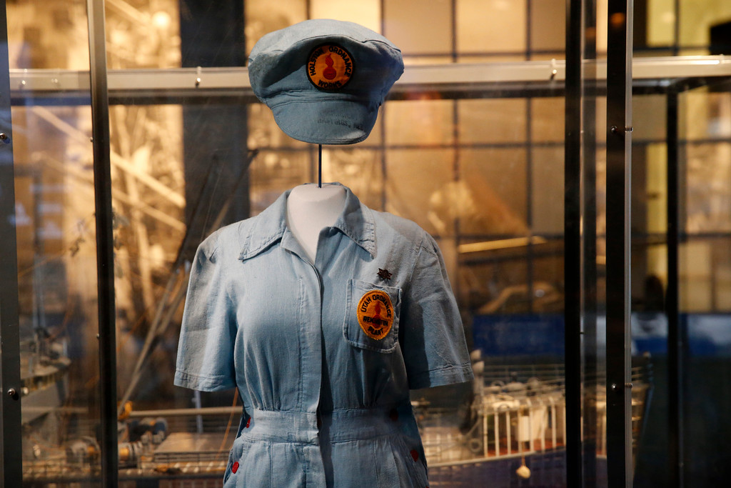 ". A female ordinance plant worker\'s uniform is part of the permanent exhibit ""Salute to the Home Front\"" at the National World War II Museum which will open to the public this Saturday, in New Orleans, Monday, June 5, 2017. The exhibit tells the home front story from the 1920s to the development of the atomic bomb. (AP Photo/Gerald Herbert)"