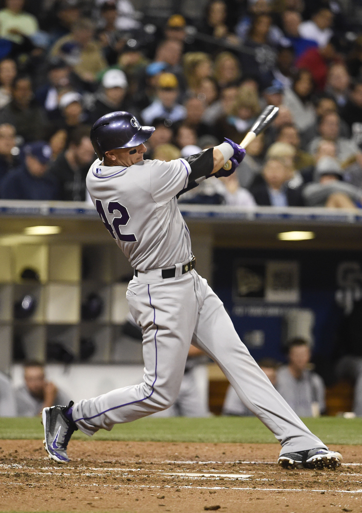 . SAN DIEGO, CA - APRIL 15:  Troy Tulowitzki of the Colorado Rockies hits a double during the fourth inning of a baseball game against the San Diego Padres at Petco Park April 15, 2014 in San Diego, California.  All uniformed team members are wearing jersey number 42 in honor of Jackie Robinson Day.  (Photo by Denis Poroy/Getty Images)