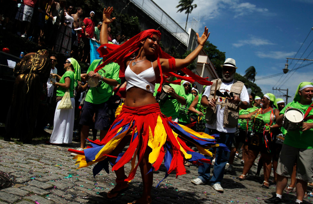 Description of . A reveller dances during the annual block party known as 'Carmelitas', one of the many carnival parties to take place in the neighbourhoods of Rio de Janeiro, February 8, 2013. REUTERS/Pilar Olivares