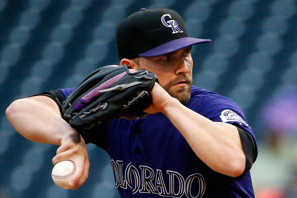 . Colorado Rockies starting pitcher Tyler Chatwood delivers during the first inning of a baseball game against the Pittsburgh Pirates in Pittsburgh, Saturday, May 21, 2016. (AP Photo/Gene J. Puskar)