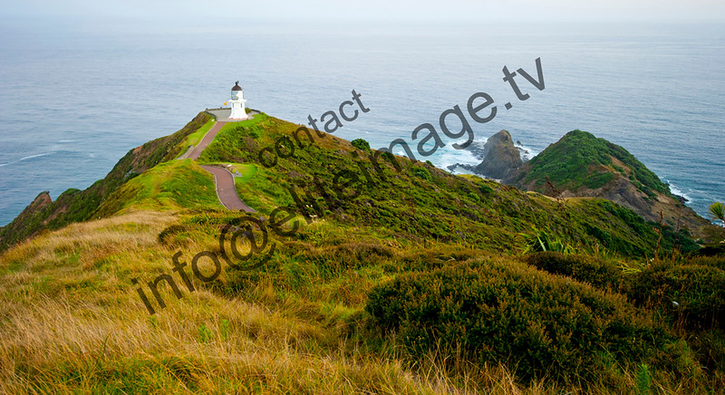 View down to the Cape Reinga Lighthouse at dawn