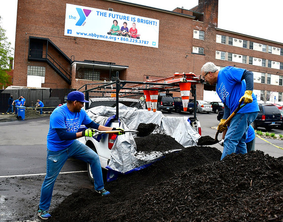 5/4/2019 Mike Orazzi | Staff Comcast's Daniel Cardoso and Ernie Magaro while cleaning up the New Britain Berlin YMCA as part of the 18th annual Comcast Cares Day on High Street in New Britain Saturday.