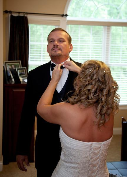 Bride adjusting grooms tie.jpg
