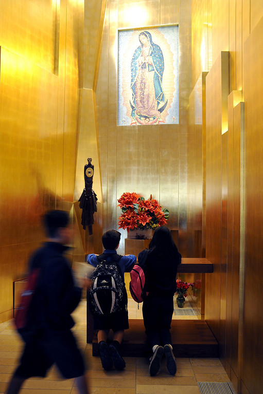 . Visitors visit the chapel where a piece of Saint Juan Diego\'s famous cloak bearing the image of Our Lady of Guadalupe is displayed at the Cathedral of Our Lady of the Angels in Los Angeles, CA November 20, 2013.(Andy Holzman/Los Angeles Daily News)