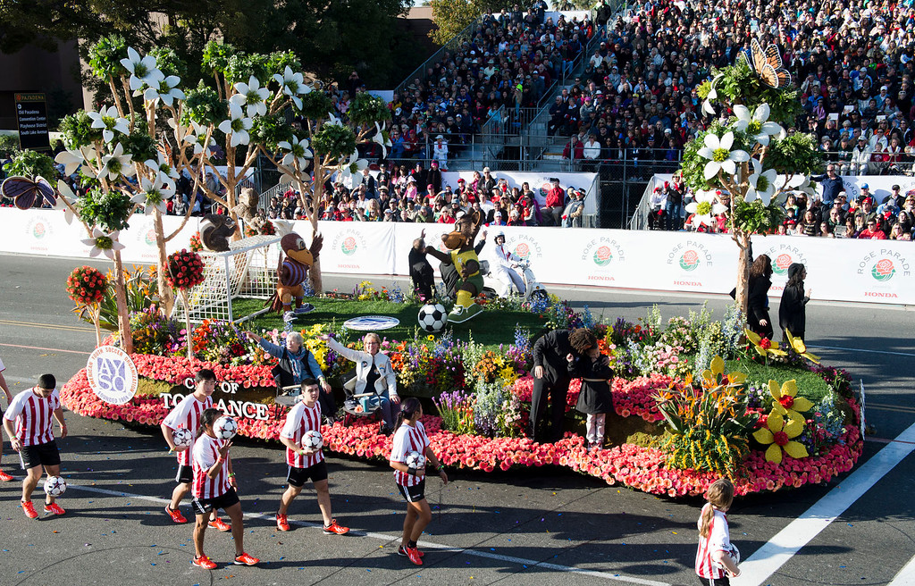 ". Torrance Rose Float Association ""Everyone Plays\"" float during 2014 Rose Parade in Pasadena, Calif. on January 1, 2014. (Staff photo by Leo Jarzomb/ Pasadena Star-News)"