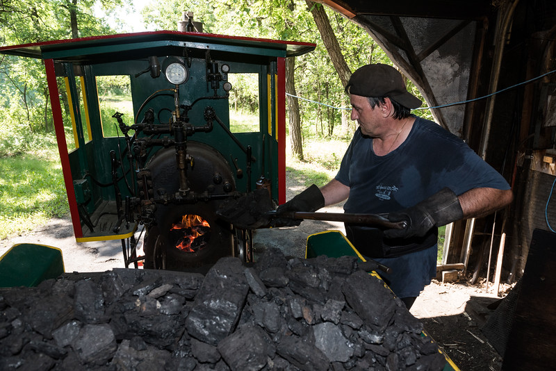 DAVID LIPNOWSKI / WINNIPEG FREE PRESS  Owner operator of the Assiniboine park railroad, Timothy Buzunis puts coal in the engine Friday July 13, 2018.