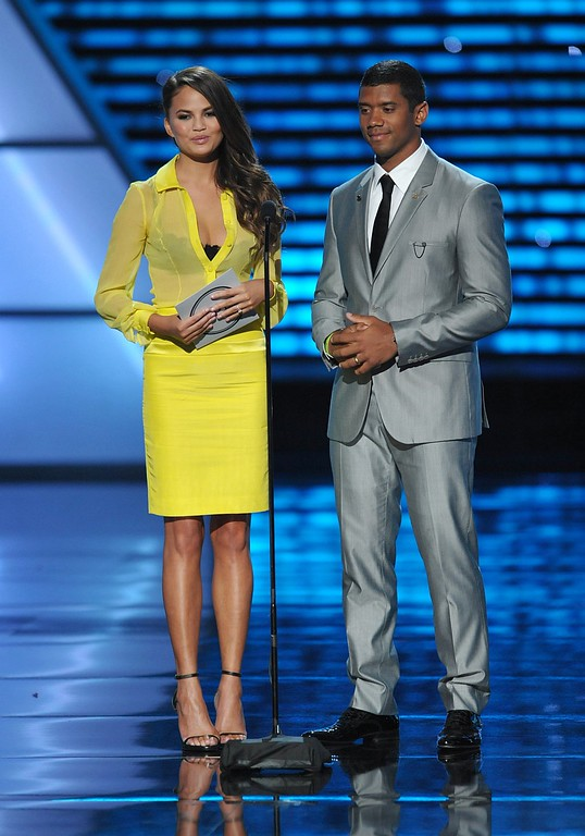 . Chrissy Teigen, left, and NFL player Russell Wilson present an award at the ESPY Awards on Wednesday, July 17, 2013, at Nokia Theater in Los Angeles. (Photo by John Shearer/Invision/AP)