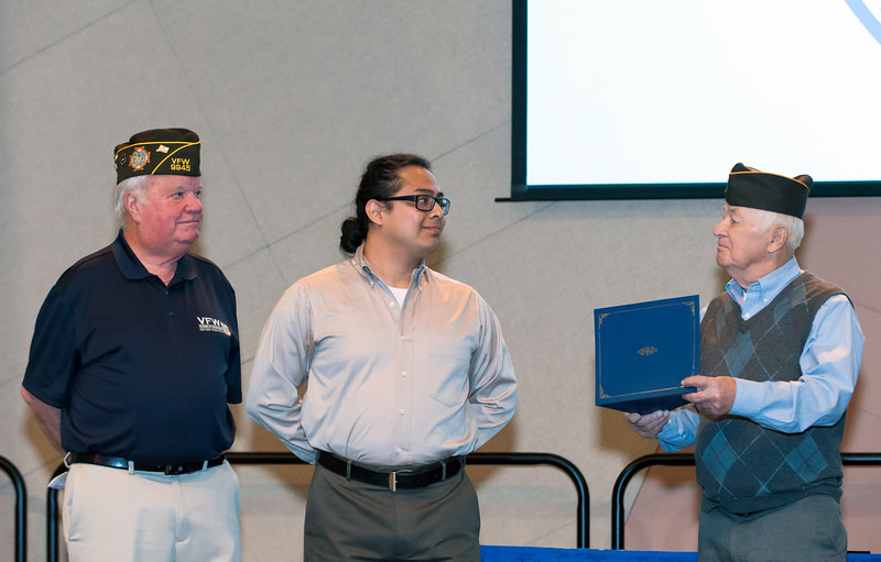 11/12/18  Wesley Bunnell | Staff  CCSU held a Veterans Day Observance on Monday afternoon in Alumni Hall which featured honoring three local veterans.  Honoree Mike Curiel, middle, receives his award from members of the VFW.