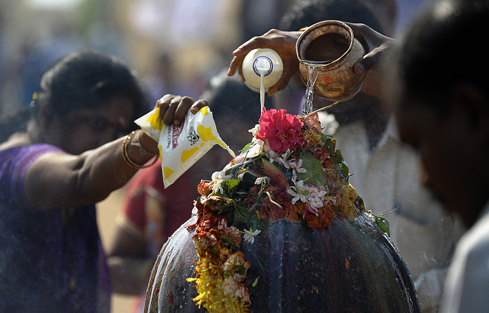 . Indian Hindu devotees offer prayers to a Shiva Lingam, a stone sculpture representing the phallus of Hindu god Lord Shiva, on Maha Shivaratri at the Keesaragutta Temple on the outskirts of Hyderabad on March 10, 2013.  The festival of Maha Shivaratri is marked by Hindus through fasting and offering prayers in a night long vigil.   NOAH SEELAM/AFP/Getty Images