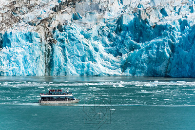 Close up view of tourist boat at glacier face