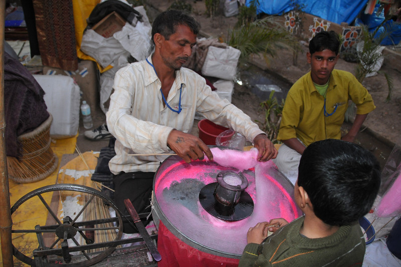 Buddi ka baal. Candy floss being made and sold at Surajkund Mela.  Suraj Kund Mela 2009 held in Haryana (outskirts of Delhi), North India. The Suraj Kund Mela is an annual fair held near Delhi. Folk dances, handicrafts and a lot of fun.