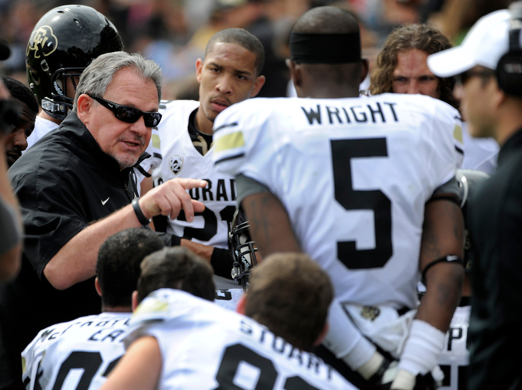 . BOULDER, CO.- APRIL13: Defensive coordinator Kent Baer instructs his players on the bench. The University of Colorado football team hosts its spring football game at Folsom Field under the direction of new head coach Mike MacIntyre. (Photo By Kathryn Scott Osler/The Denver Post)