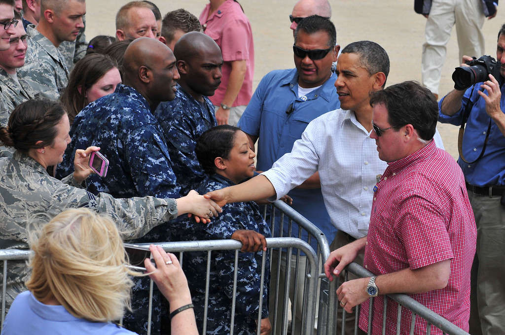 . President Barack Obama greets a group of armed forces personnel and several families affected by the May 20th tornado at Tinker Air Force Base as he departed from his visit to Moore, Okla. on Sunday May 23, 2013 in Oklahoma City. (AP Photo/Nick Oxford)