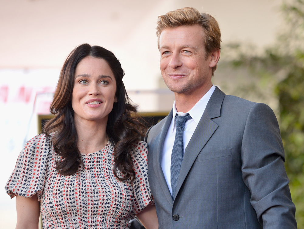 Description of . Actress Robin Tunney and actor Simon Baker attend a ceremony honoring Simon Baker with the 2,490th Star on The Hollywood Walk of Fame on February 14, 2013 in Hollywood, California.  (Photo by Alberto E. Rodriguez/Getty Images)
