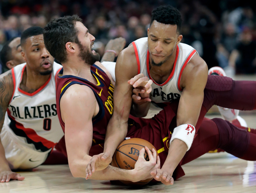 . Portland Trail Blazers\' Evan Turner, right, tries to get the ball loose from Cleveland Cavaliers\' Kevin Love in the first half of an NBA basketball game, Tuesday, Jan. 2, 2018, in Cleveland. (AP Photo/Tony Dejak)