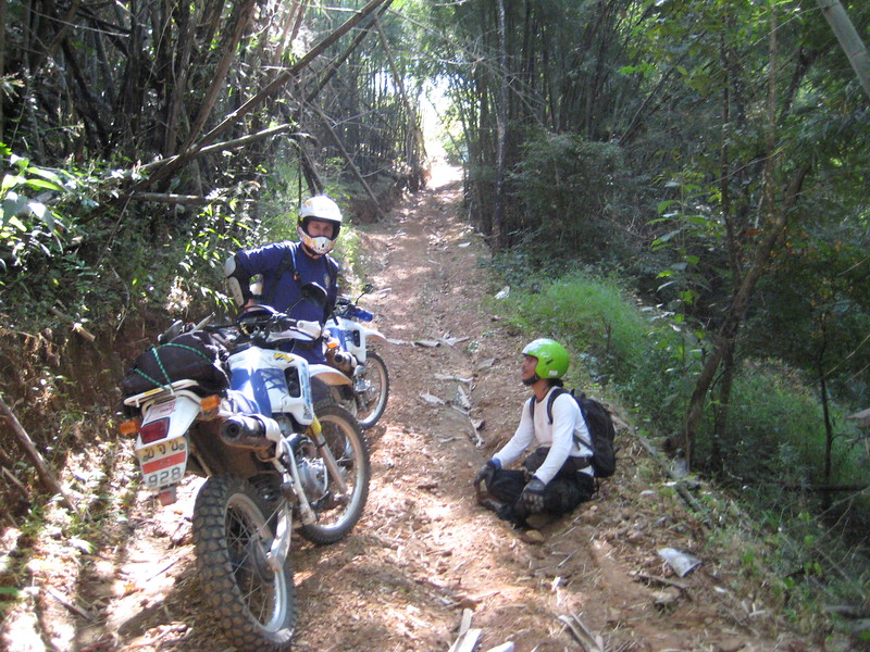 Sa-ngiam takes a break after we pull his motorbike out of the bush off the right side of the track.