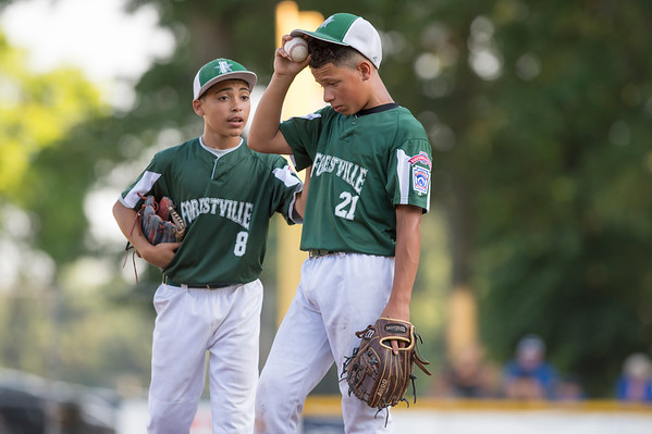 07/08/19 Wesley Bunnell | Staff Forrestville vs Southington North Little League baseball at Recreation Park in Southington on Monday July 8, 2019. Hector Martinez (8) comforts Aiden Lopez (21) on the mound.