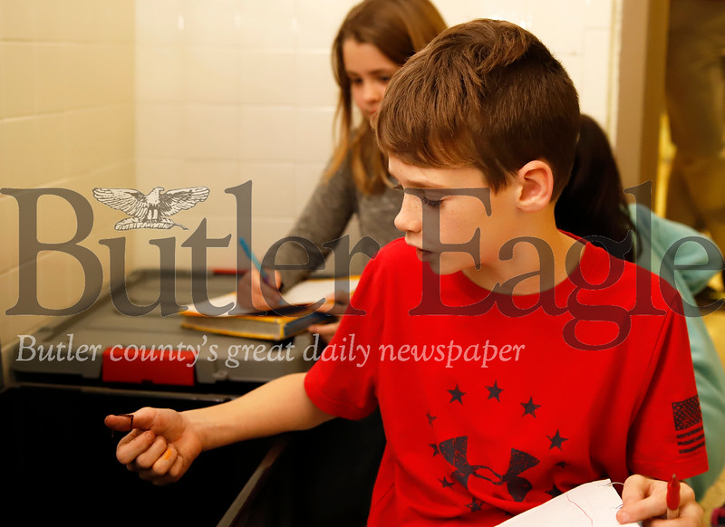 Evan Taylor handles a composting worm in Butler Middle School's Fisheries Program Nursery. Seb Foltz/Butler Eagle