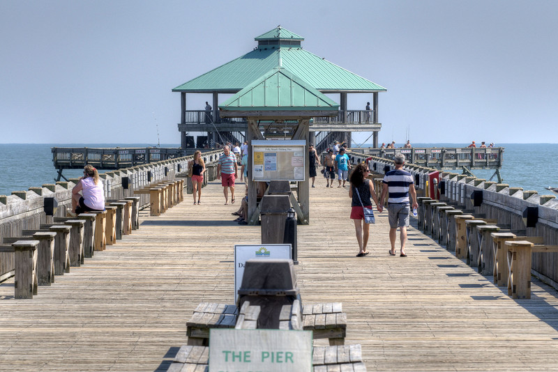 People walk and fish on the Edwin S. Taylor Fishing Pier in Folly Beach, SC on Sunday, September 8, 2013. Copyright 2013 Jason Barnette