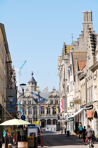 View on a shopping street leading to the Grand market square in Veurne, Belgium.