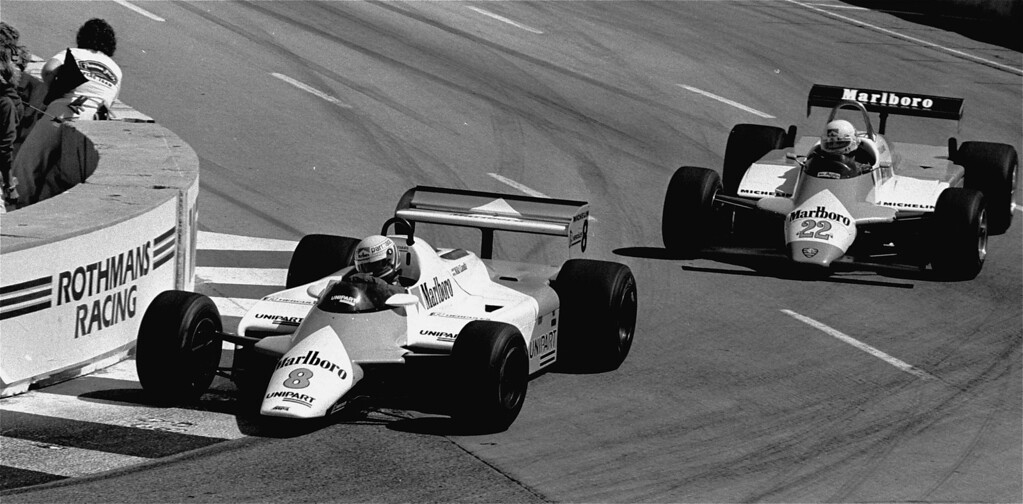 . Two-time Formula 1 world champion Niki Lauda of Austria, driving car No.8 for Team McLaren, passes Alfa Romeo driver Bruno Giacomelli of Italy in car No.22 during early lap of the Long Beach Grand Prix April 4, 1982. Lauda, who ended a two-year retirement to drive on the 1982 Grand Prix circuit, won the race. (AP Photo/Reed Saxon)