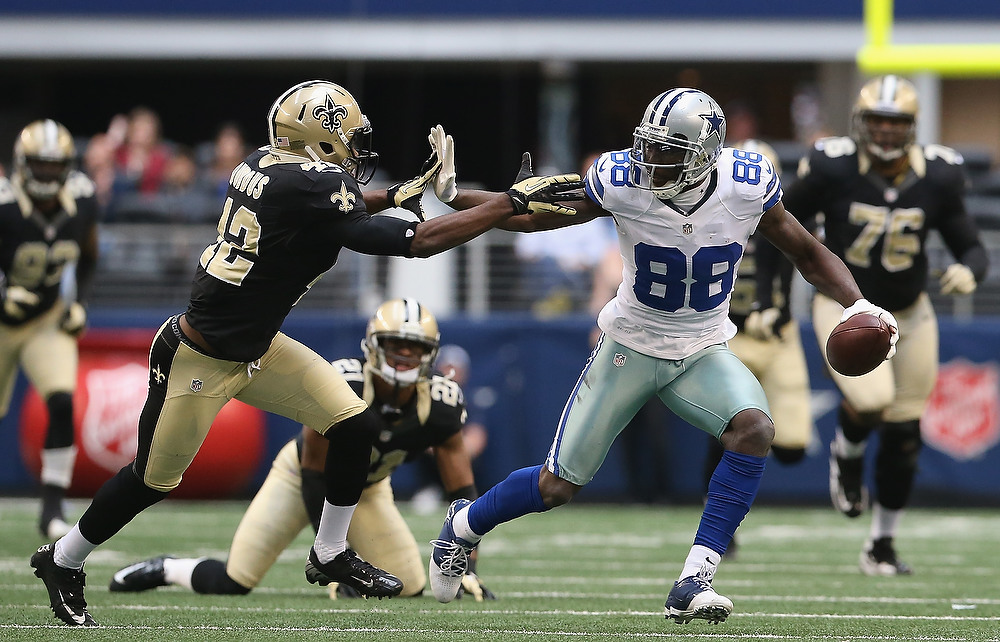 . Dez Bryant #88 of the Dallas Cowboys runs for a touchdown past  Isa Abdul-Quddus #42 of the New Orleans Saints at Cowboys Stadium on December 23, 2012 in Arlington, Texas.  (Photo by Ronald Martinez/Getty Images)