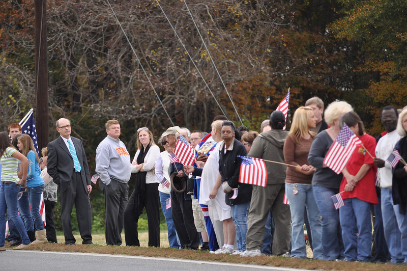 The crowd begins to gather along the route, in the front lawn of Crestview Baptist Church