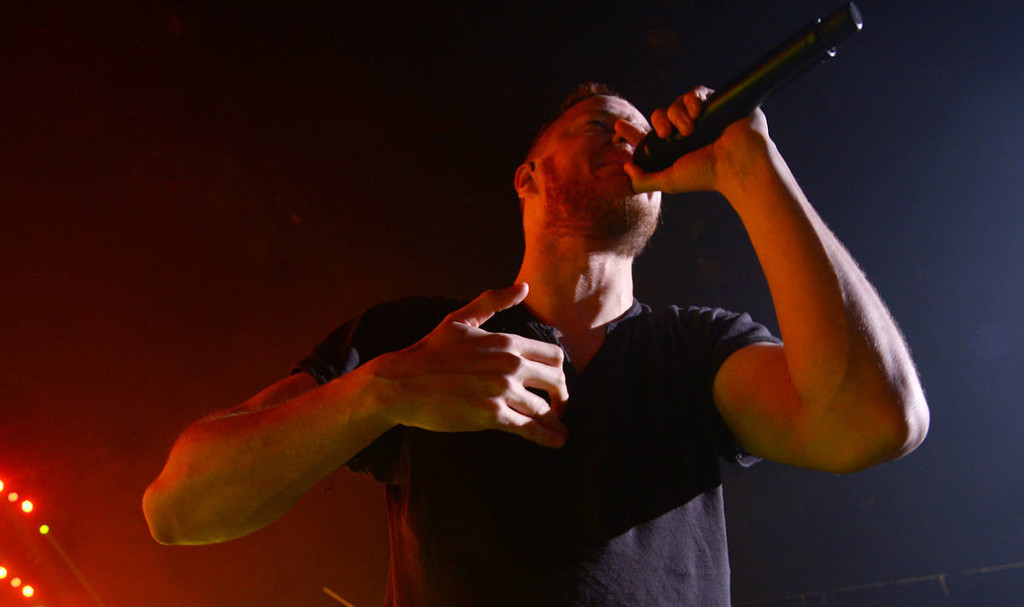 . Dan Reynolds of Imagine Dragons performs during the band\'s \'Into The Night Tour\' stop at the Xcel Energy Center in St. Paul on Wednesday, March 12, 2014. (Pioneer Press: John Autey)