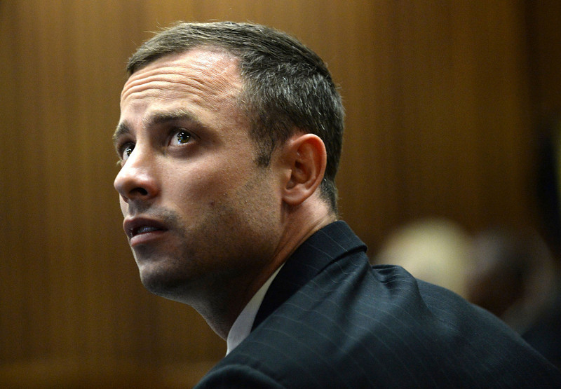 . Oscar Pistorius sits in the dock on the second day of his trial at the high court in Pretoria, South Africa, Tuesday, March 4, 2014. Pistorius is charged with murder for the shooting death of his girlfriend, Reeva Steenkamp, on Valentines Day in 2013. (AP Photo/Antoine de Ras, Pool)