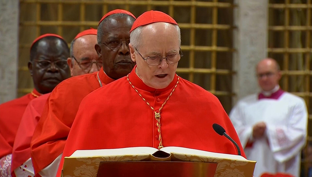 . In this image made from video provided by Vatican CTV television, Brazilian Cardinal Odilo Pedro Scherer, of Brazil, right, takes an oath of secrecy inside the Sistine Chapel, at the Vatican, Tuesday, March 12, 2013, before the start of the conclave to elect the 266th Roman Catholic Church pope. Behind Scherer are Cardinals John Njue, of Kenya, Raul Eduardo Vela Chiriboga, of Ecuador, and Laurent Monsengwo Pasinya, of the Democratic Republic of Congo.  (AP Photo/CTV via APTV)