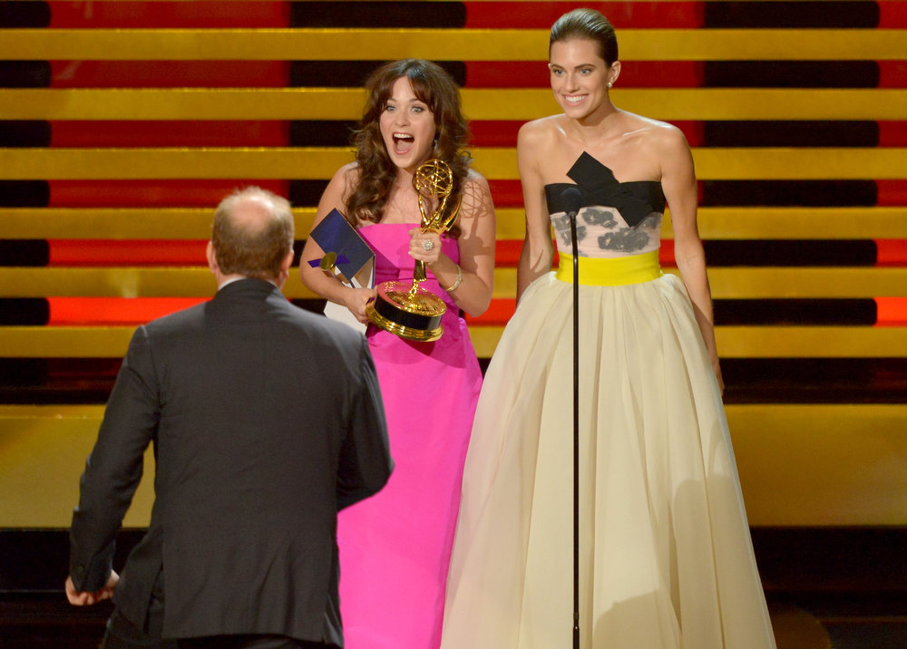 . Actor/writer Louis C.K. (L) accepts Outstanding Writing for a Comedy Series for the \'Louie\' episode \'So Did the Fat Lady\' from actresses Zooey Deschanel and Allison Williams onstage at the 66th Annual Primetime Emmy Awards held at Nokia Theatre L.A. Live on August 25, 2014 in Los Angeles, California.  (Photo by Kevin Winter/Getty Images)