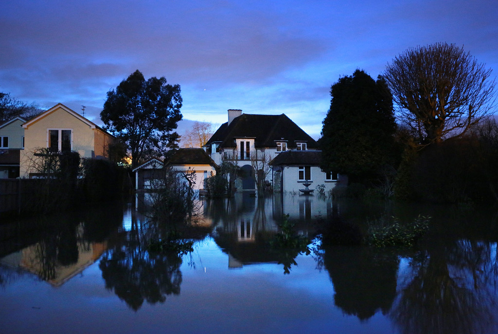 . Flooded homes at night fall on February 11, 2014 in Wraysbury, England. Some say that they will stay in their houses even though they have been offered help to evacuate as flood water rises.  (Photo by Peter Macdiarmid/Getty Images)
