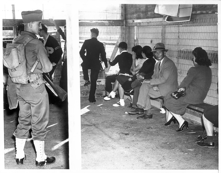 """""""Here is a view of some of the Japanese taken into custody by FBI officers when a ferry from Terminal Island docked at San Pedro"""" -- caption on photograph"""
