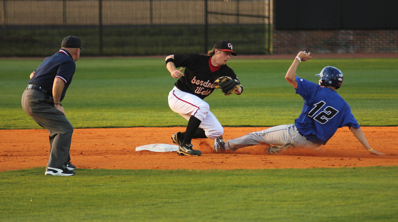 Second Baseman Daniel Merck attempts to get the runner out at the bag but #12 Danny Baatz of UNC-Asheville was called safe by umpire Steve Sanders.