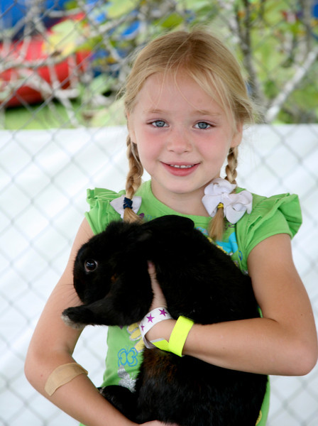 Allison Thompson holds bunny at Petting Zoo