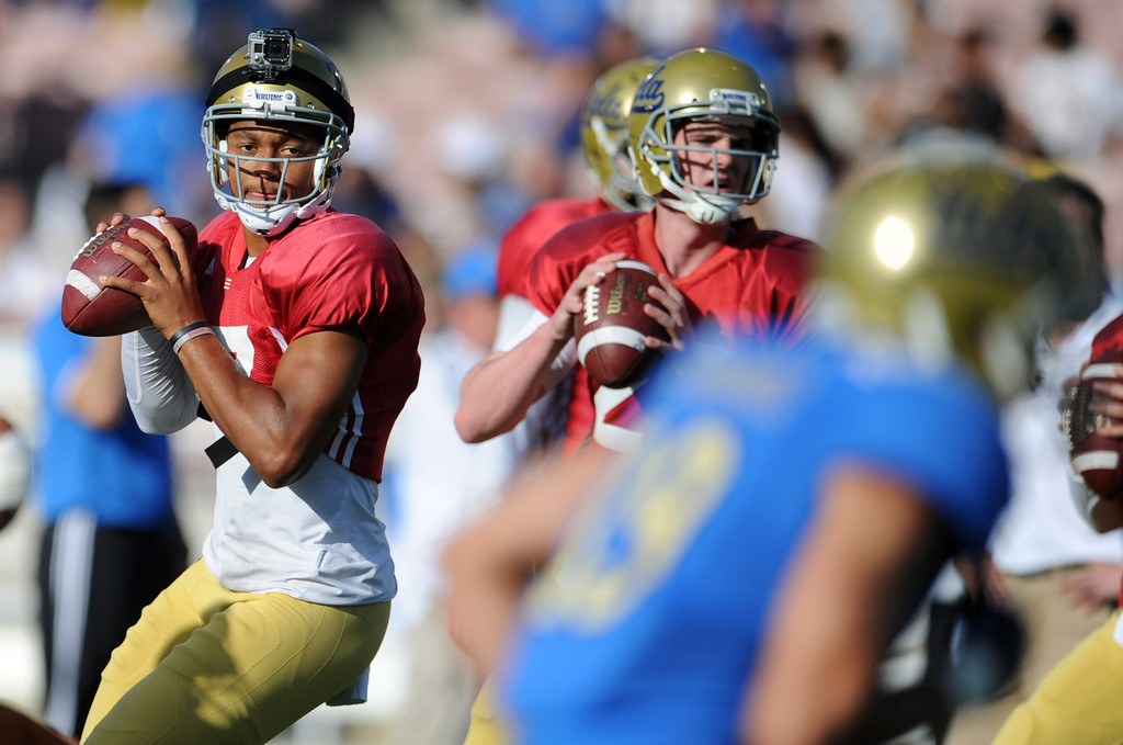 . UCLA quarterback Brett Hundley (17), center, and quarterback Jake Hall (29) during the football spring showcase college football game in the Rose Bowl on Saturday, April 27, 2013 in Pasadena, Calif.    (Keith Birmingham Pasadena Star-News)