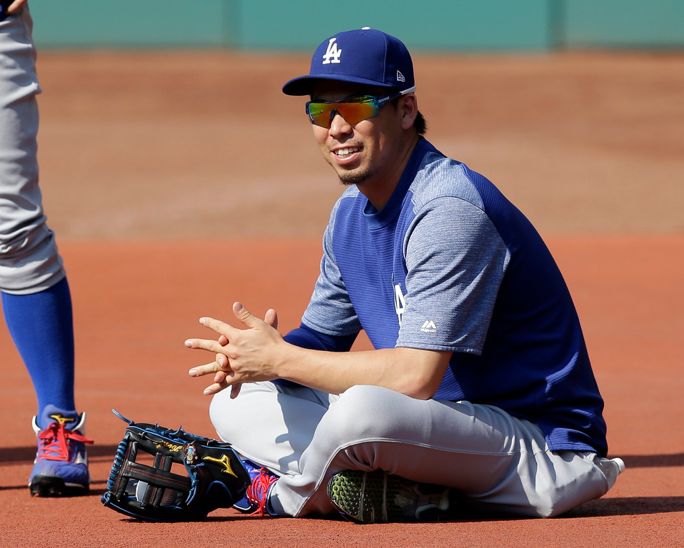 . Los Angeles Dodgers starting pitcher Kenta Maeda watches batting practice before an interleague baseball game between the Los Angeles Dodgers and the Cleveland Indians, Tuesday, June 13, 2017, in Cleveland. (AP Photo/Tony Dejak)