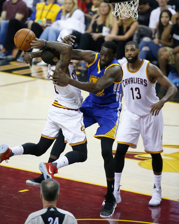 . Golden State Warriors forward Draymond Green (23) defends Cleveland Cavaliers guard Kyrie Irving (2) in the first half of Game 4 of basketball\'s NBA Finals in Cleveland, Friday, June 9, 2017. (AP Photo/Ron Schwane)