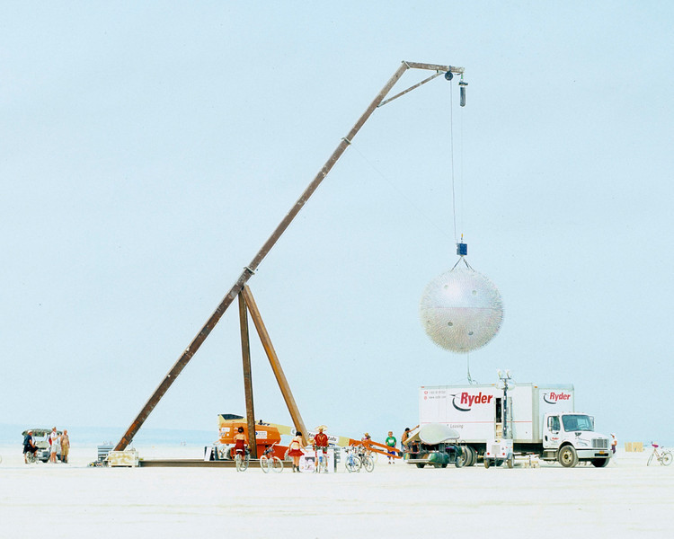 Giant metal ball with thousands of toothbrush spikes being installed.