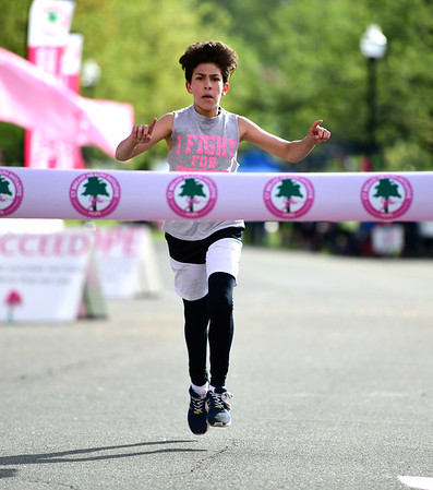 5/11/2019 Mike Orazzi | Staff Gabriel Alvarez takes first place in the kids mile race during the 16th annual Race in The Park held Saturday in New Britain.