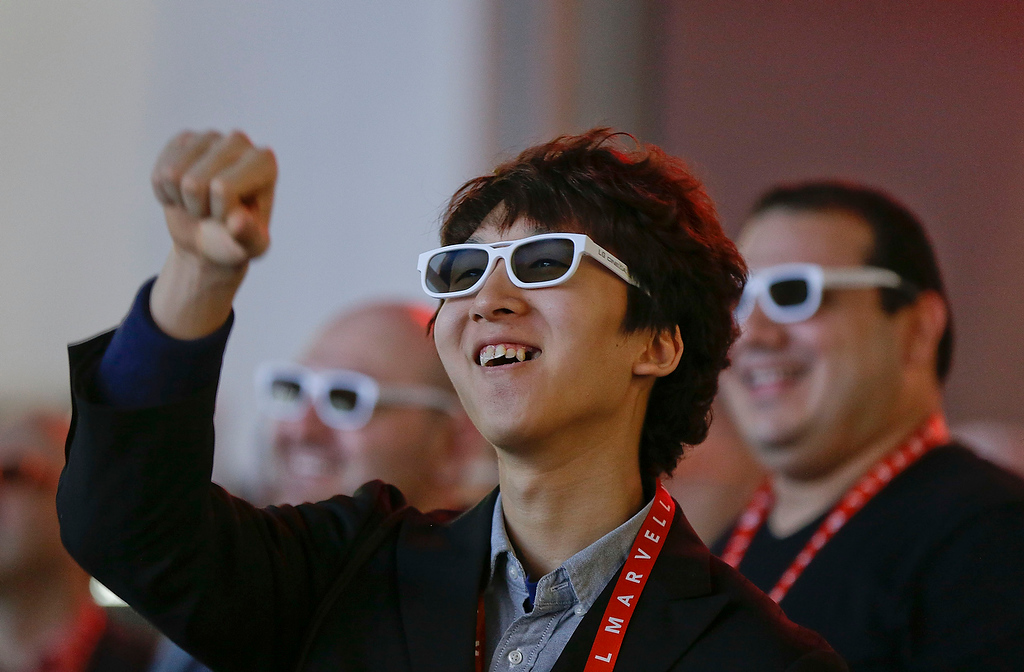 . Junho Kim reaches out toward the screen while watching a 3-D video display at the LG booth at the Consumer Electronics Show, Thursday, Jan. 10, 2013, in Las Vegas. (AP Photo/Julie Jacobson)